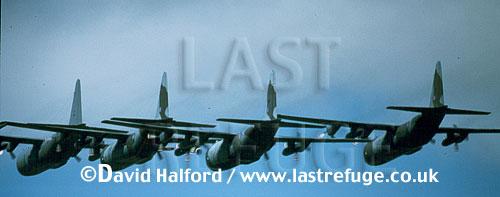 Lockheed C-130 / C.130 / C130 Hercules C.1s x 4, flying in formation, RAF, (R)IAT, RAF Fairford, UK, July 1995