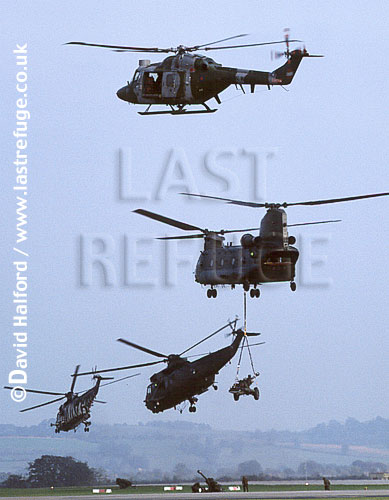 Boeing Vertol Chinook H.C.3 / Chinook HC-3 / Chinook HC3 and underslung field gun, Lynx and 2 x Sea Kings, Royal Navy, Royal Naval Air Station (RNAS) Yeovilton, UK, September 2002