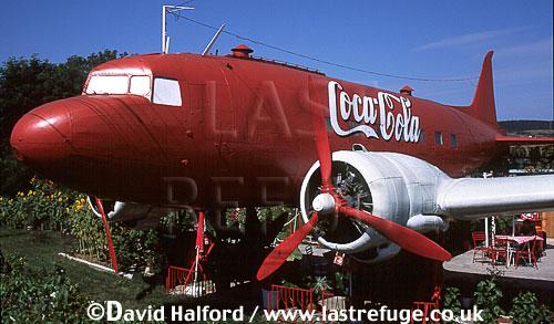 Lisunov Li-2 / Li.2 / Li2 (or licence-built Douglas DC-3 or C-47), Coca-Cola markings, used as cafe east of Lugoj on Timisoara road, Romania, September 2001