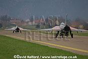 Saab / SAAB J35OE / J 35OE (originally J35D / J 35D) Drakens (18 + 06) of the Oesterreichische Luftstreitskraefte (Austrian Air Force)'s Ueberwachungsgeschwader (Air Superiority Wing) taxying - Zeltweg Air Base, Austria / April 2005