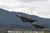 Saab / SAAB J35OE / J 35OE (originally J35D / J 35D) Drakens (21 + 12) of the Oesterreichische Luftstreitskraefte (Austrian Air Force)'s Ueberwachungsgeschwader (Air Superiority Wing) taking off - Zeltweg Air Base, Austria / April 2005
