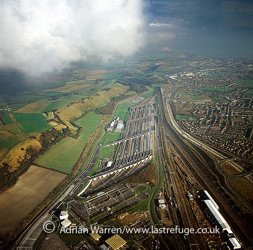The Channel Tunnel (Chunnel or Eurotunnel is a 50.450?km long rail tunnel beneath the English Channel at the Strait of Dover, connecting Folkestone, Kent, England