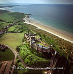 Bamburgh Castle, built on a basalt outcrop on the coast at Bamburgh in Northumberland, England