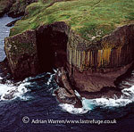 Fingal's Cave, hexagonally-jointed basalt columns cliffs, on uninhabited island of Staffa, Inner Hebrides, West Coast Scotland