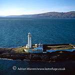 Lighthouse at Eilean Musdile, Southern tip of Lismore Isle, near Isle of Mull, Inner Hebrides, West Coast Scotland