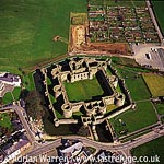 Beaumaris Castle on Island of Anglesey, Village centre, 24 m west of Conwy. Stone fortress, concentric, octagonal, North Wales