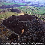 Carn Fadryn Castle, Llyn Peninsula, Gwynedd. Stone walled hill fort with stone huts., North Wales