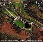 Manorbier Castle, Village centre, 6 m SE of Pembroke. Impressive stone curtain walls and towers, South Wales