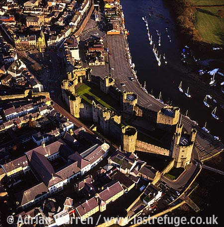 Caernarfon (or Caernarvon), Town with town wall on the Menai Strait, North Wales