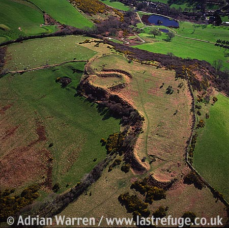 Caer Penrhos, Earthworks of magnificent ringwork castle built within an earlier Iron Age hill Fort. Just east of Llanrhystud, near the coast, 8 m S of Aberystwyth, South Wales