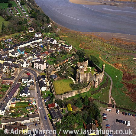 Laugharne Castle, In town of Laugharne, Carmarthenshire. Impressive stone ruin on the estuary of the River T?f, South Wales