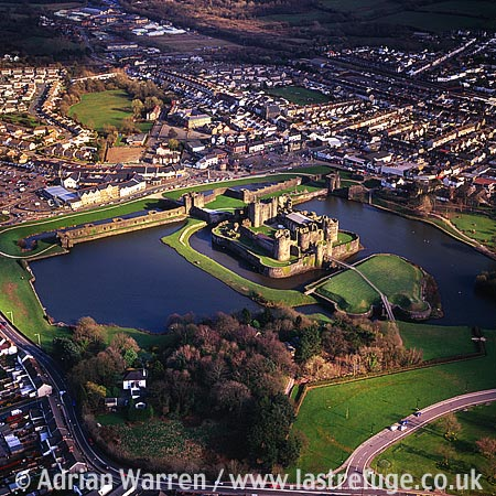 Caerphilly Castle, largest castle in Wales, Caerphilly town centre, 7 m N of Cardiff. Impressive stone concentric fortress, forming an island., South Wales