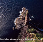 The Old Man of Hoy, 137?metre sea stack of red sandstone perched on a plinth of igneous basalt, close to Rackwick Bay on the west coast of the island of Hoy, Orkney Islands, Scotland