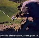 Todhead Point, a headland with Stevenson-built lighthouse of the eastern coastline of Aberdeenshire, Scotland
