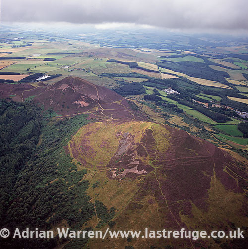 Eildon Hill, hill fort south of Melrose, Borders, Scotland. Sometimes pluralised into -the Eildons- or -Eildon Hills-, because of its triple peak.