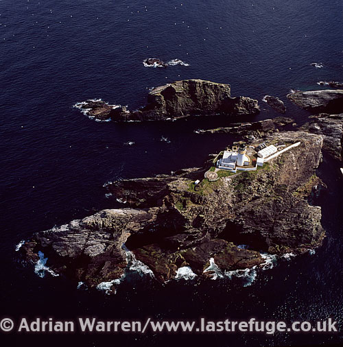 Muckle Flugga and Lighthouse, a small rocky island north of Unst, Shetland Islands, Scotland