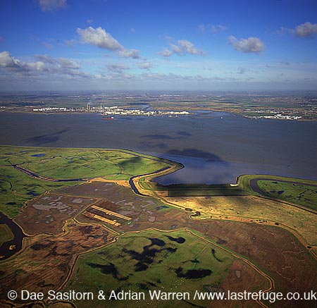Looking across the Estuary of the River Thames from Halstow Marshes to Thames Haven and Canvey Island, Kent, England
