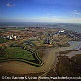 Colemouth Creek on the River Medway, Isle of Grain, looking east to Sheerness and Estuary of the River Thames, England