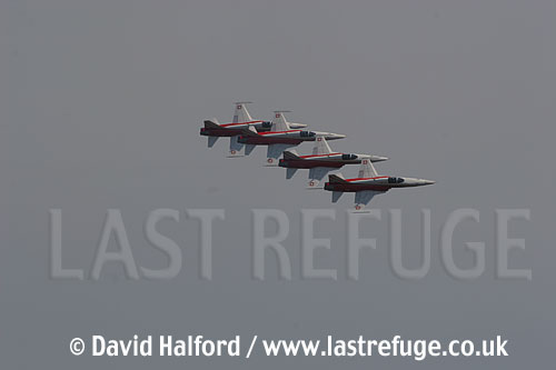 Northrop F-5E Tiger IIs x 4 of Patrouille Suisse flying, Cazaux, June 2005