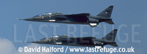 SEPECAT Jaguar Es x 2 of Armee de l'Air (French Air Force) flying / Royal International Air Tattoo (RIAT) / RAF Fairford, UK, U.K., United Kingdom / July 1996