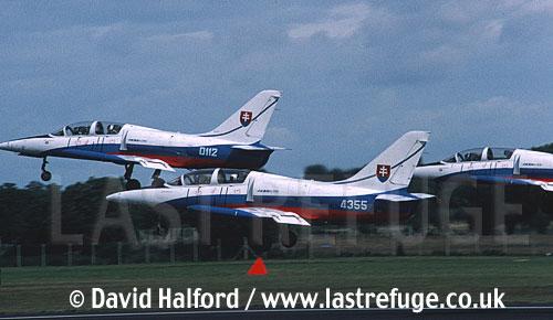 Aero L-39s x3 of Slovak Air Force's White Albatrosses team taking off / Royal International Air Tattoo (RIAT) / RAF Fairford / July 1998