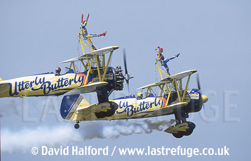 Stearman 450s x 2 of the Utterly Butterly Trio flying - Bigg