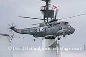 Large military transports: Westland Sea King HAS.6 (XV648-18) landing on HMS Illustrious, Greenwich, London, U.K., 7th May 2