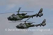 Small military transports: Aerospatiale-Westland Gazelle AH.1s x2 of 671 Sqn AAC, Blue Eagles, RIAT, RAF Fairford, U.K., 07-