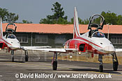 Northrop F-5E Tiger IIs x 2 of Patrouille Suisse taxying, Cazaux, June 2005