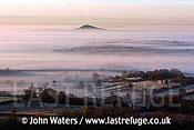Mist over Somerset Levels, Glastonbury Tor in distant, UK