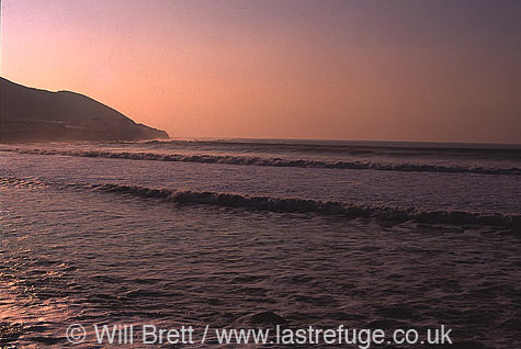 Evening surf at Westward Ho! Beach looking south west towards Greencliff