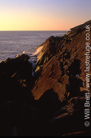 Baggy point looking west over near vertical strata of eroded rock at sunset