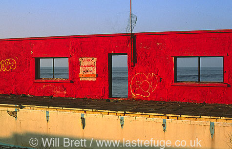 Derelict swimming pool with graffiti near Braddicks holiday park westward Ho! Looking over Bideford bay