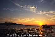 Sunset looking west from Instow beach towards Tor and Torridge estuary with Appledore village in far left of image