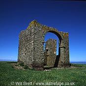 Tower ruin on The Warren near Stoke village. Lundy island visible in background