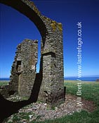 Detail of ruin structure, tower ruin on The Warren near Stoke village. Lundy island visible in background