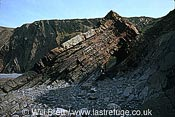 Closer shot of eroded rock strata forming a passage at Hartland quay beach