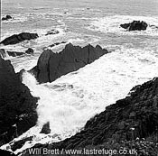 Eroded rock strata beaten by wind swell and incoming tide at Screda point, south of Hartland Quay