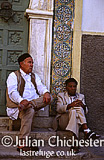Men passing the time of day in the Madina (medieval walled town) in Tripoli, Libya