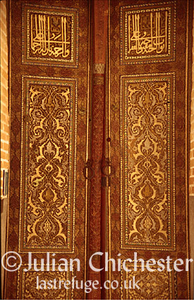 Doors leading into the Kussam - ibn Abbas Mosque, housing the tomb of Kussam - ibn Abbas, a cousin of the Prophet Mohammed. The Shah-I-Zinda, Samarkand, Uzbekistan. 1460 AD.