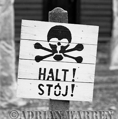 Auschwitz Nazi Death Camp: Halt! sign deterring prisoners from venturing near the 6,000 volt perimeter fence.