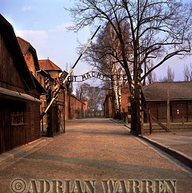 Auschwitz Nazi Death Camp: Above the Main Gate, a cynical; sign: -ARBEIT MACHT FREI- means -WORK BRINGS FREEDOM-. Each day, prisoners were marched to and from their places of slave labour through this gateway.