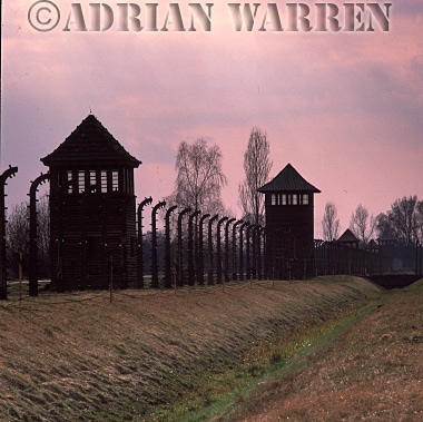 Auschwitz Nazi Death Camp: Watch towers along the electrified perimeter fence of Auschwitz II - Birkenau.