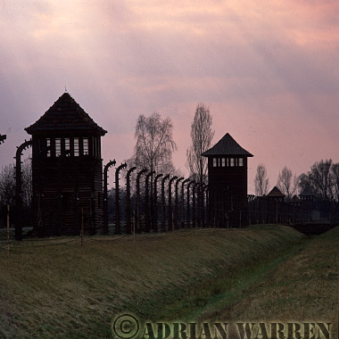 Auschwitz Nazi Death Camp: Guard watch towers and the electrified perimeter fence at Auschwitz II - Birkenau.