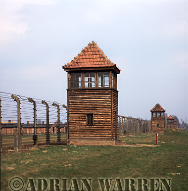 Auschwitz Nazi Death Camp: Guard watch towers an the electrified perimeter fence at Auschwitz II - Birkenau.