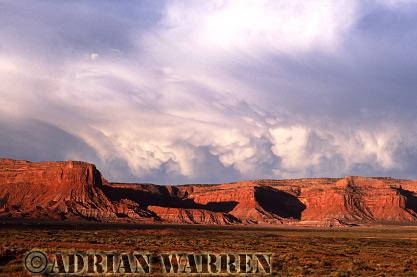 Rain clouds with Mamnatus, near Monument Valley, Arizona, USA