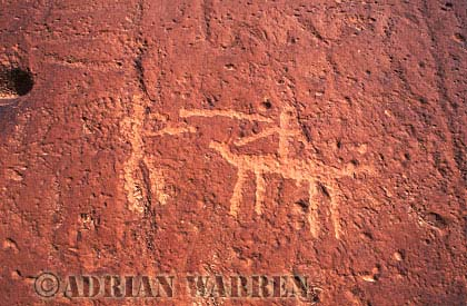Man throwing spear at rider on horse ROCK ART - Petroglyphs, Sand Island Recreation Area, San Juan River, Utah, USA