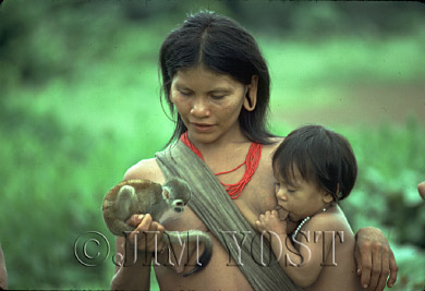Waorani Indians: Children grow up around pets, like the squirrel monkey, quickly learning their habits, Gabado, 1975, Ecuador
