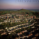 Glastonbury with Glastonbury Tor and St Michael's Tower in background, glastonburuy, Somerset, England