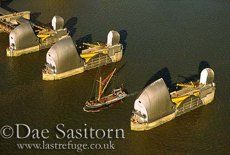 River Thames Barge and River Thames Barrier, London, England